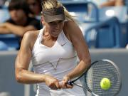 Sharapova overcomes Lisicki to reach quarters in Madrid