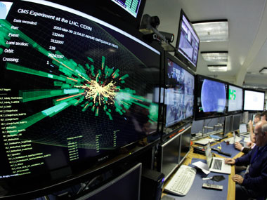 A graphic showing a collision at full power is pictured at the Compact Muon Solenoid (CMS) experience control room of the Large Hadron Collider (LHC) at the European Organisation for Nuclear Research (CERN) in Meyrin, near Geneva in this file photo. Denis Balibouse/Reuters.