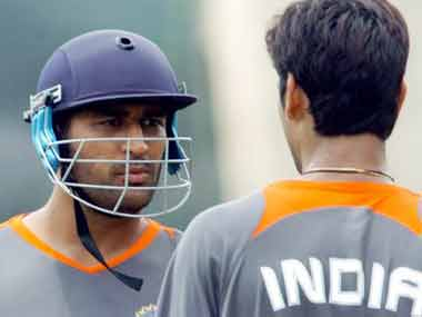 Dhoni with RP Singh in this file photo. AFP