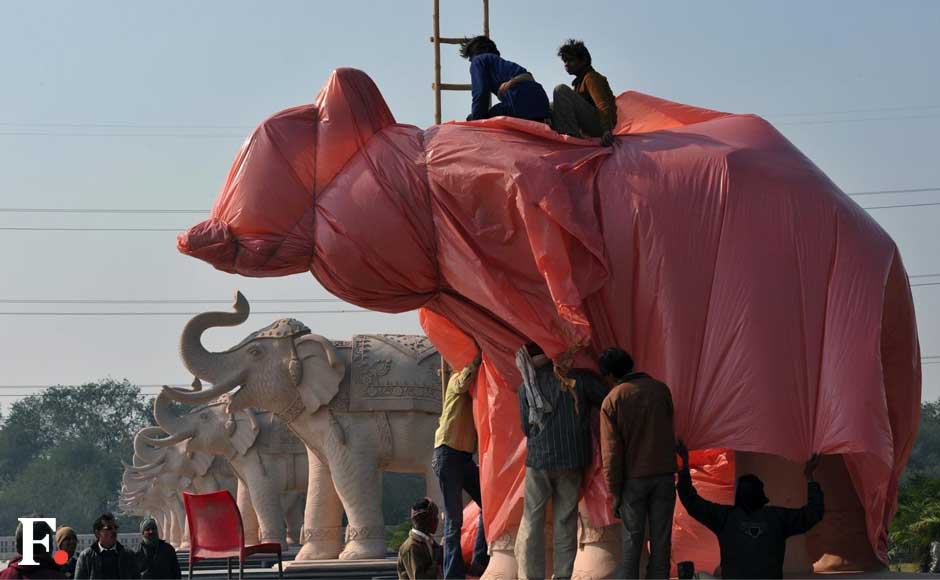 Images: Race on to cover Mayawati statues, elephants