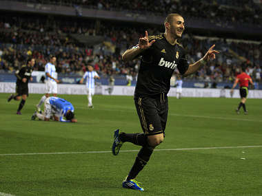 Real Madrid's Benzema celebrates after scoring against Malaga during their Spanish Kings Cup soccer match in Malaga. Reuters
