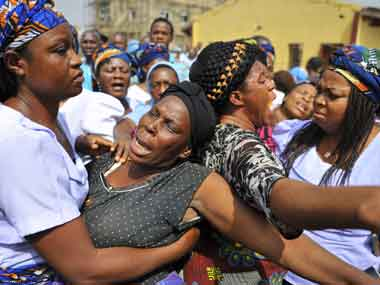 Women weep over their loved ones who died in the Christmas day bomb explosion at St. Theresa's Catholic church in Madalla, just outside the capital Abuja on 31 December 2011. Reuters