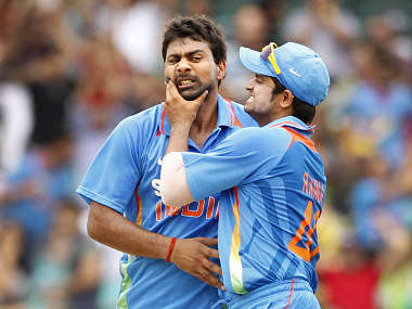 India's Raina congratulates team mate Kumar after he took the wicket of Australia's Forrest during their one-day international cricket match in Sydney. Reuters