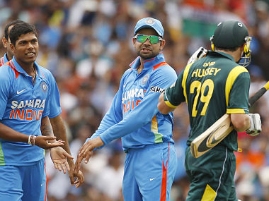 India's Yadav and Kohli make comments to Australia's Hussey as he walks from the field after he was dismissed during their one-day international cricket match against India in Sydney. Reuters