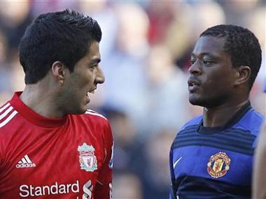 Suarez and Evra look look at each other during their English Premier League soccer match at Anfield in Liverpool. Reuters