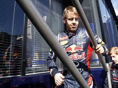 Red Bull Formula One driver Sebastian Vettel of Germany walks by the paddock during a training session at Circuit de Catalunya racetrack. Reuters
