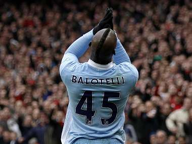 Manchester City's Balotelli reacts before he receves a red card during their English Premier League soccer match against Arsenal in London. Reuters