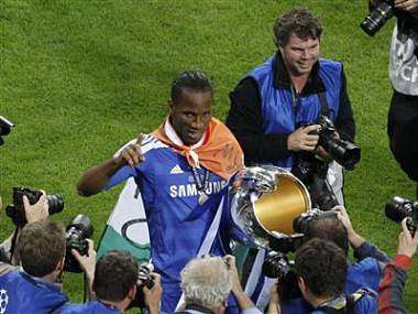 Drogba of Chelsea celebrates with the UEFA Champions League trophy after winning the final soccer match against Bayern Munich at the Allianz Arena in Munich. Reuters