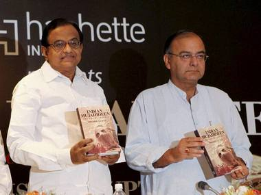 Former Union finance minister and Congress leader P Chidambaram with Union Finance Minister Arun Jaitley. PTI