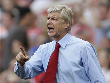 Arsenal's manager Arsene Wenger shouts to his players during the English Premier League soccer match between Arsenal and Sunderland. AP
