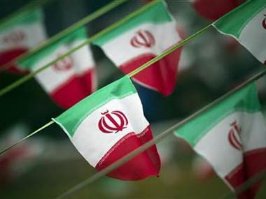 IranFlag_Reuters Official: Iran would take action if US attacked Syria