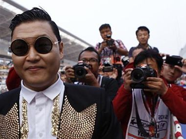 South Korea singer Psy poses for photographers before the podium ceremony of the South Korean F1 Grand Prix at the Korea International Circuit in Yeongam. Reuters