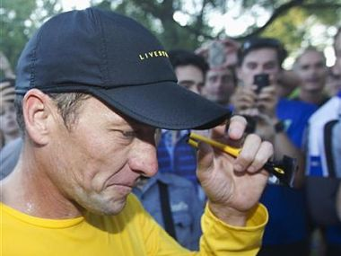 Lance Armstrong walks back to his car after running at Mount Royal park with fans in Montreal. Reuters