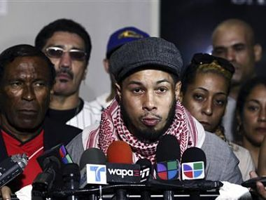 Hector Camacho Jr. gives a news conference outside the Rio Piedras Medical Center where his father is being treated after being shot in the face, in San Juan. Reuters