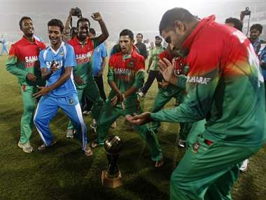 Bangladesh players celebrate victory over the West Indies. AP