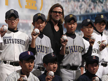 File picture of actor Brad Pitt with Japanese school baseball players. Reuters