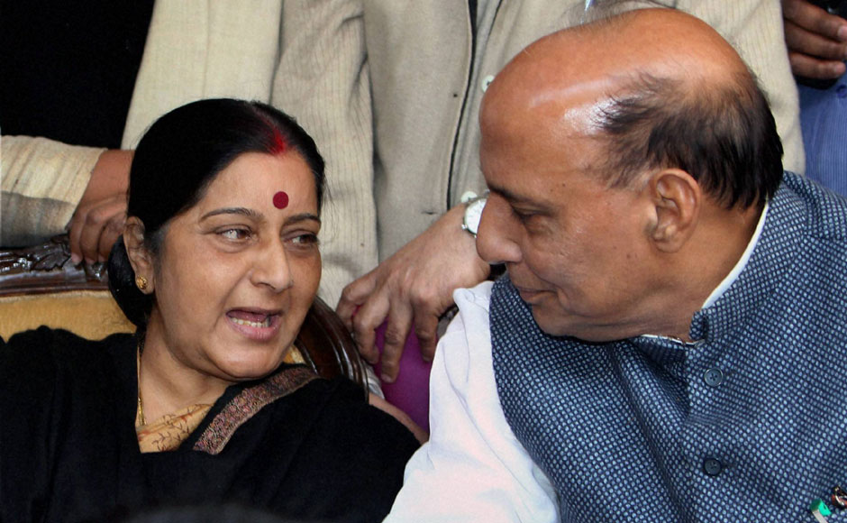 Sushma Swaraj and Rajnath Singh exchange a word during the protest at Jantar Mantar. PTI