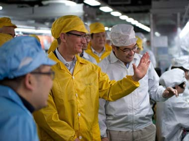 Tim Cook during a visit to a Foxconn China factory last year. Reuters