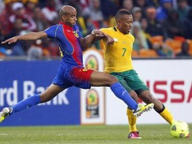 South Africa's Majoro is challenged by Cape Verde's Nivaldo during opening match of AFCON 2013 soccer tournament in Soweto. Reuters