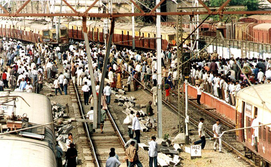 Trade union activists stop trains in central Bombay during a 24 hours strike in the western Indian state of Maharashtra 25 April 2001. The strike, affecting the entire  industrial heartland of the state of which Bombay is the capital, was enforced by a rare alliance of trade unions and parties across the political spectrum to protest against the federal  government's liberal reformist economic policies. All public transport vehicles, including buses, taxis and auto-rickshaws, were off the streets. AFP