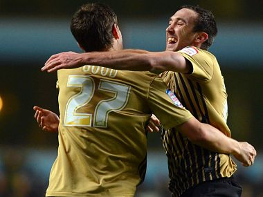 Bradford City's Rory McArdle celebrates beating Aston Villa with teammate Curtis Good. AFP