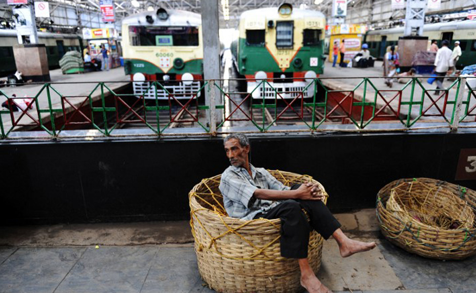 An Indian porter relaxes at a train station as commuters are stranded during Congress party supporters' 12-hour strike in Kolkata on July 17, 2009. Normal life was disrupted across West Bengal with rail and road traffic severely affected as a 12-hour strike was called in protest against an alleged attack by Communist Party of India (Marxist) (CPI-M) supporters on Congress party state legislative members (MLAs) in Mangalkot in Burdwan district, reported local media. AFP