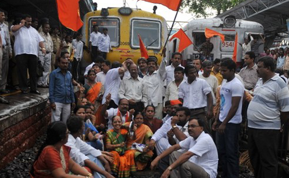 Shiv Sena party workers shout slogans as they stop local trains during a nationwide strike in protest of fuel price hikes in Mumbai on 5 July, 2010. The strike was called by the main opposition Bharatiya Janata Party (BJP) and leftist parties in a concerted show of strength against the Congress-led government's reform programme. AFP
