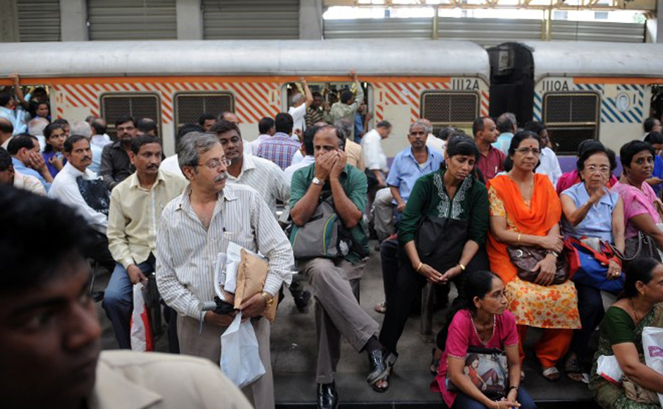 Stranded commuters are pictured at the Churchgate railway station in Mumbai on 20 July, 2012. The railway services on the western side of the city came to a near halt after a section of motormen went on strike -- just prior to evening rush hour traffic -- demanding better work conditions. AFP