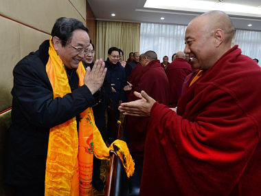 In this Jan. 8, 2013 photo released by China's Xinhua News Agency, Yu Zhengsheng, left, a Standing Committee member of the Political Bureau of the Communist Party of China (CPC) Central Committee, is greeted by a participant during a seminar held with Tibetan Buddhist representatives in Ganzi Tibetan. AP