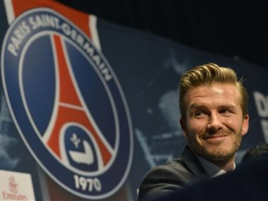 British soccer player David Beckham, smiles during a press conference at the Parc des Princes stadium. AP