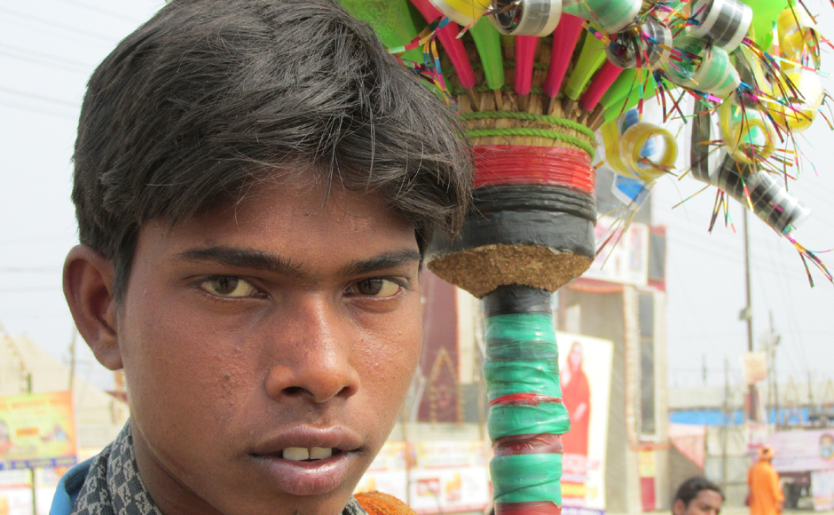 Seventeen years old Sudeesh is from Bihar's Chhapra district. He sells flutes for a living. After Maha Kumbh, he says, his next stop will be Pushkar mela in Rajasthan in November. In the interim, he will do odd jobs. Danish Raza/ Firstpost