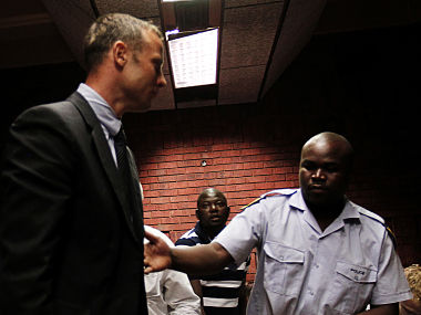 South African 'Blade Runner' Oscar Pistorius (C) is escorted by police during his court appearance in Pretoria. Reuters
