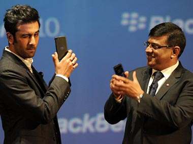 Ranbir Kapoor (L) poses with the BlackBerry Z10 as Managing Director for BlackBerry India, Sunil Dutt looks on at the country launch of the BlackBerry Z10 in Mumbai. AFP