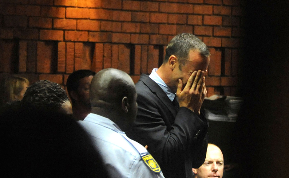 Athlete Oscar Pistorius weeps in court in Pretoria, South Africa, at his bail hearing in the murder case of his girlfriend Reeva Steenkamp. AP