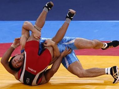 File photo of Japan's Tatsuhiro Yonemitsu (in blue) fighting with India's Sushil Kumar. Reuters