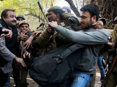 Police detain a group of students during a protest against the hanging of Parliament attack convict Afzal Guru at Jantar Mantar in New Delhi on Saturday. PTI