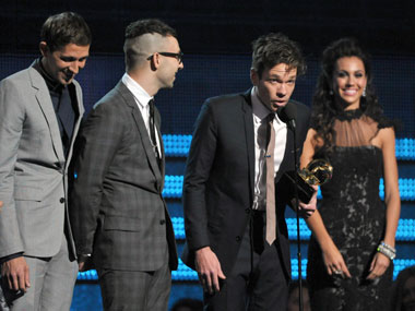 Members of fun. accept the award for song of the year at the 55th annual Grammy Awards on Sunday. AP