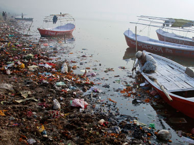 A man cleans his boat at the ongoing Kumbh Mela in Allahabad. Reuters