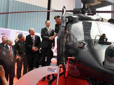 Chairman, HAL, RK Tyagi handed over the Rudra to Deputy Chief of Army Staff Lt Gen Narendra Singh in Bangalore on Friday. Image courtesy PIB