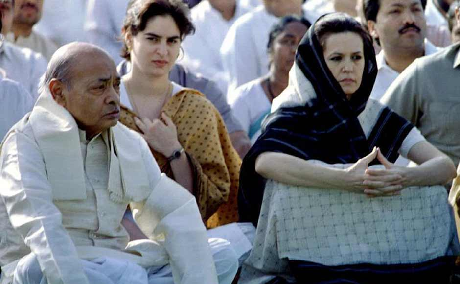Sonia Gandhi with Congress president and Prime Minister Narasimha Rao at a prayer ceremony in 1995. Sonia had allegedly already begun playing a role in the Congress despite not being a member of the party. Reuters