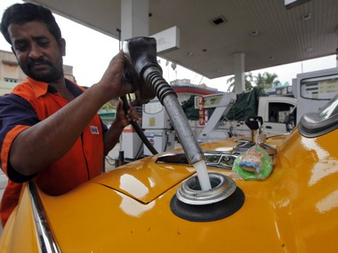 An employee fills a taxi with diesel at a fuel station in Kolkata. Reuters
