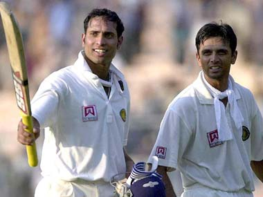 VVS Laxman and Rahul Dravid return to the dressing room after a good day's work. AFP