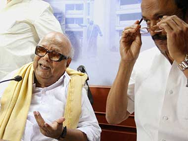 Karunanidhi and son Stalin at the press conference. PTI