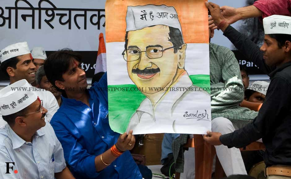 Supporters of Arvind Kejriwal hold up his poster in New Delhi on Saturday. Naresh Sharma/ Firstpost