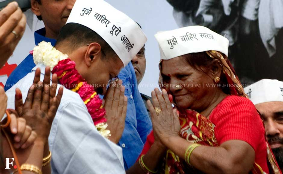 Arvind Kejriwal is greeted by one of his supporters as he starts his fast. Naresh Sharma/ Firstpost