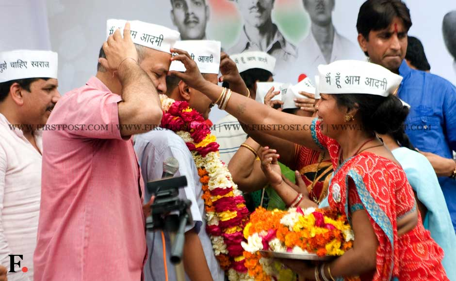 Arvind Kejriwal's supporters garland him as he begins his fast. Naresh Sharma/ Firstpost