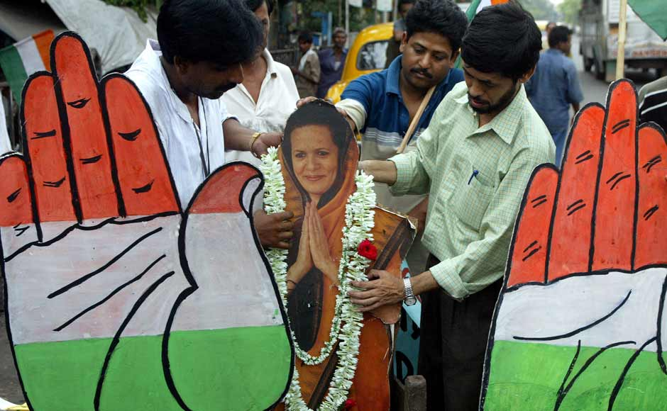 Activists of Congress Party put garlands on a cutout of party president Sonia Gandhi in Calcutta in May 2004 after the party swept back to power as India voted out the BJP. Prime Minister Atal Behari Vajpayee conceded defeat. Reuters