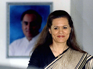 Sonia Gandhi, stands in front of her husband, Rajiv Gandhi's portrait at New Delhi residence in this 1996 file photo.