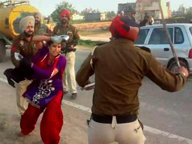 Punjab police officials caught on camera beating a woman has raised questions about pending police reforms. PTI