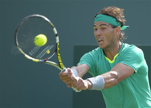 Rafael Nadal, of Spain, makes a return against Juan Martin del Potro, of Argentina, during their match at the BNP Paribas Open tennis tournament. AP